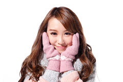 Young woman wearing winter clothing Stock Images