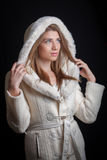 Young woman wearing winter coat Stock Photo