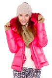 Young woman wearing winter jacket scarf and cap Stock Photos
