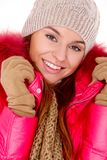 Young woman wearing winter jacket scarf and cap Stock Photography