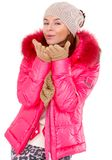 Young woman wearing winter jacket scarf and cap Stock Photo
