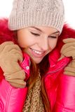 Young woman wearing winter jacket scarf and cap Stock Image