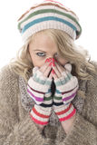 Young Woman Wearing a Wooly Hat and Gloves Stock Photography