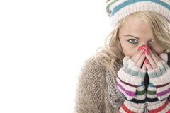 Young Woman Wearing a Wooly Hat and Gloves Royalty Free Stock Photos