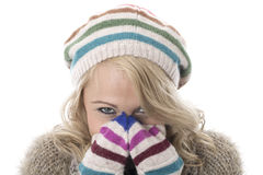 Young Woman Wearing a Wooly Hat and Gloves Royalty Free Stock Photography