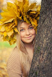 Young woman. Wearing a wreath of autumn leaves royalty free stock images