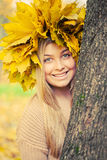 Young woman. Wearing a wreath of autumn leaves stock image