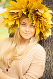 Young woman. Wearing a wreath of autumn leaves royalty free stock image
