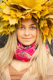 Young woman. Wearing a wreath of autumn leaves royalty free stock photography