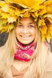 Young woman. Wearing a wreath of autumn leaves stock images