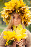 Young woman wearing a wreath of leaves Royalty Free Stock Images
