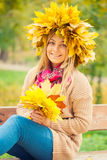 Young woman wearing a wreath of leaves Royalty Free Stock Photo