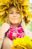 Young woman wearing a wreath of leaves. Young woman wearing a wreath of autumn leaves royalty free stock images