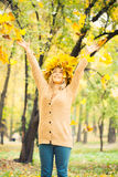 Young woman wearing a wreath of leaves. Young woman wearing a wreath of autumn leaves royalty free stock photos