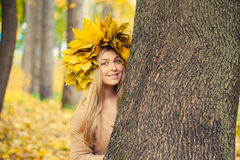 Young woman wearing a wreath of leaves Royalty Free Stock Photos