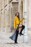 Young woman wearing yellow leather jacket Royalty Free Stock Images