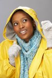 Young Woman Wearing Yellow Raincoat In Studio Royalty Free Stock Photo