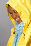 Young Woman Wearing Yellow Raincoat In Studio Royalty Free Stock Photos
