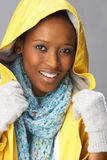 Young Woman Wearing Yellow Raincoat In Studio Stock Image