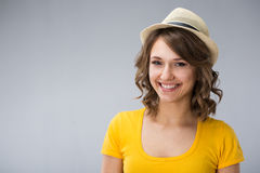 Young woman wearing yellow shirt hat and jeans shorts  make face Stock Photos