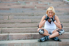 Young woman wears roller skates Stock Photos