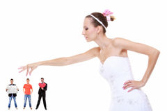 Young woman in wedding dress choosing candidate for husband stock image
