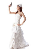 Young woman in a wedding dress with gun. Stock Photography