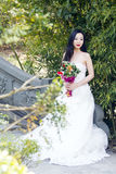 A young woman wedding photo/portrait sit on an ancient old bridge in Shanghai shui bo parkpark of water. Shot in park of water Shanghai shui bo park in Shanghai royalty free stock image