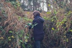 Young woman weeding garden Stock Photos