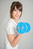 Young woman weight training Stock Photography