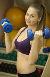 Young woman weight workout with two dumbbells Stock Photos