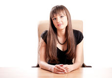 Young woman welcomes at the desk Royalty Free Stock Image