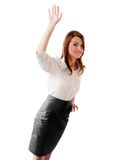 Young woman welcomes you. The young office-style ladi is greeting you Royalty Free Stock Photo