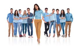 Young woman welcomes you in her casual team stock images