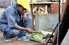 Young woman welder at work. Royalty Free Stock Images