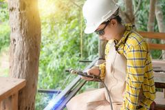Young women in are welding steel stock image