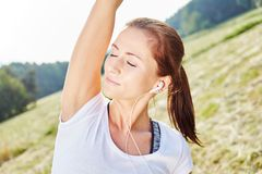 Young woman in wellness class. Listens to music with mp3 player stock images
