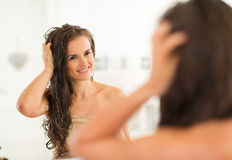 Young woman with wet hair in bathroom Royalty Free Stock Photo