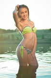 Young woman with wet hair in bikini sunbathing Stock Photo