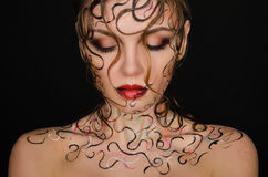 Young woman with wet hair and face art Royalty Free Stock Photo