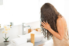 Young woman with wet hairs in bathroom Royalty Free Stock Photos