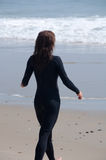 Young Woman in a Wetsuit at Beach Stock Image