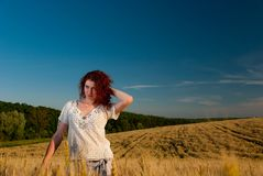 Young woman at wheat Royalty Free Stock Photography