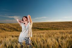 Young woman at wheat Stock Photos