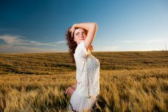 Young woman at wheat Stock Photo