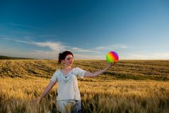 Young woman at wheat Stock Photography
