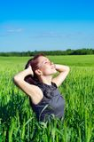 Young woman in the wheat field Royalty Free Stock Image