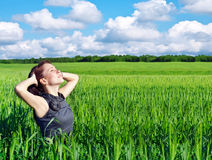 Young woman in the wheat field Royalty Free Stock Photography