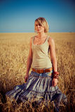 Young woman on wheat field Royalty Free Stock Photography