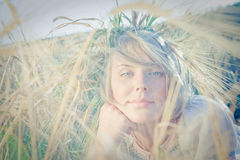 Young woman on wheat field Stock Photography